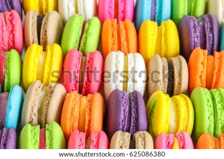 Colorful french macarons background, close up.Different colorful macaroons background.Tasty sweet color macaron,Bakery concept.Selective focus. #625086380