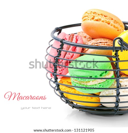 Colorful French macaroons isolated over white