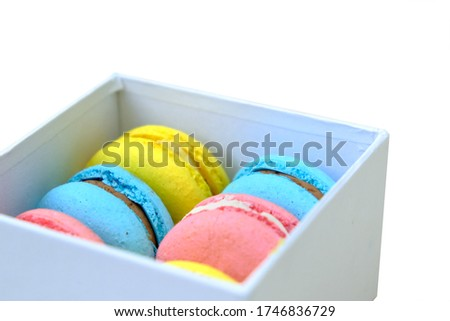 Colorful french Sweet Pastries Macaroons in White Gift Box with Copy Space. For Cafe or Bakery advertising. Isolated on white background