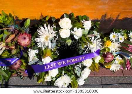"""Colorful fresh floral wreaths for Anzac Day holiday memorial celebrations 25th April in Bunbury, Western Australia to honor and remember those who gave their lives in battles- """"Lest we forget."""""""