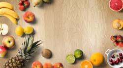 Colorful fresh fruit on wood table. Orange, strawberries, lemons, peach slice, grapefruit, limes, pears, kiwi. Summer fruit. Flat lay, top view.