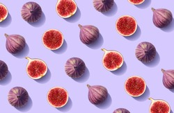 Colorful fruit pattern of fresh figs on purple pastel background, top view, flat lay