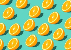 Colorful fruit pattern of fresh orange slices on green background top view orange fruit pattern background Flat lay orange background cut and full orange