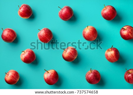 Colorful fruit pattern of fresh red apples on blue background. From top view - Shutterstock ID 737574658