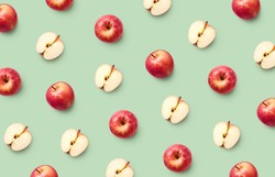 Colorful fruit pattern of fresh red apples on light green background