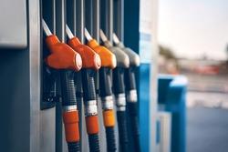 Colorful gasoline dispenser background. Fuel pumps service station , copy space.