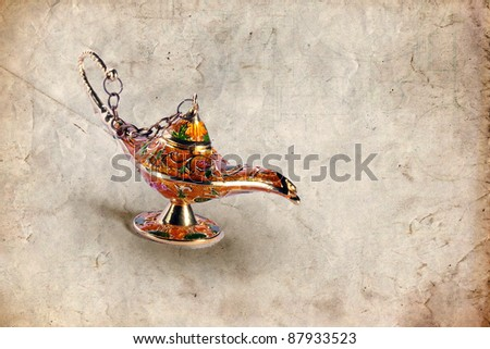 Colorful genie lamp also called Aladdin lamp on grungy background