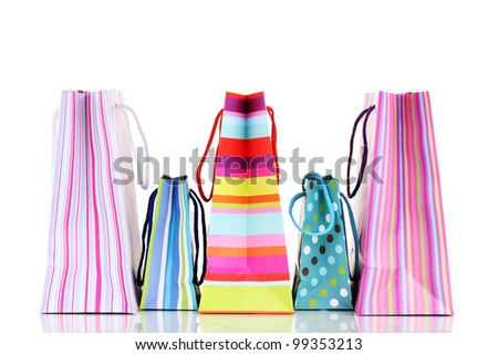Colorful gift bags isolated on white