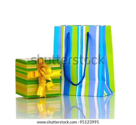 Colorful gift bags with gifts isolated on white