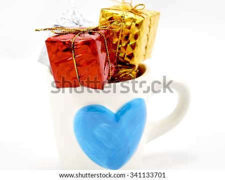 Colorful gift box in a blue heart logo cup #341133701