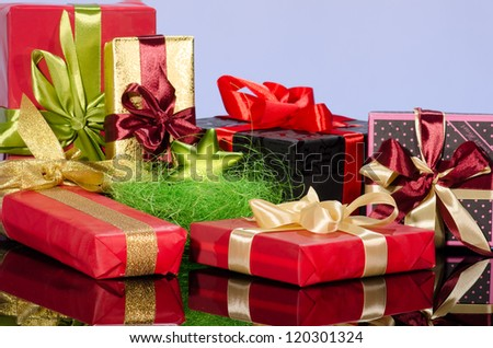Colorful gift boxes and christmas arrangement against blue background