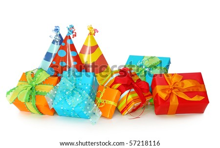 Colorful gift boxes and party hats isolated on white background