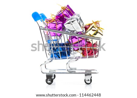 colorful gift boxes in steel shopping cart