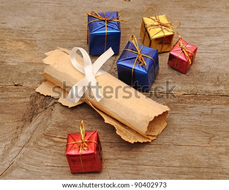 colorful gift boxes with an old scroll - stock photo