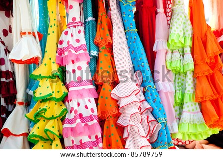 stock photo : colorful gipsy flamenco dresses on rack hanged in Spain market