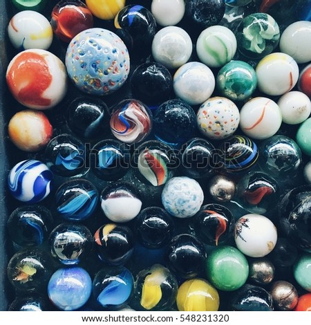Lots of Colorful Marble Balls on Green background Images and Stock