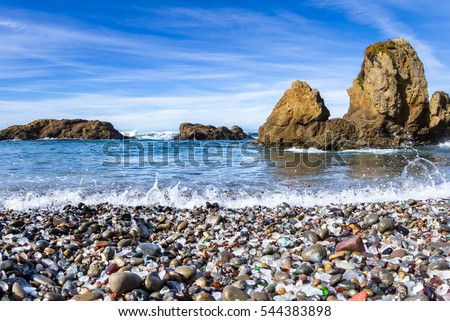 colorful glass pebbles blanket this beach in Fort Bragg, the beach was used as a garbage dump years ago, nature has tumbled the glass and polished it making it a tourist destination