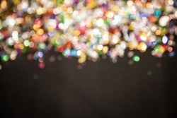 colorful, gold light Festive Christmas background. Abstract twinkled bright background with bokeh defocused golden lights