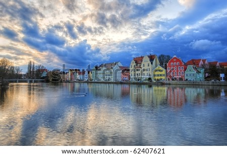Colorful gothic houses lined on a river kay in an old bavarian town near Munich