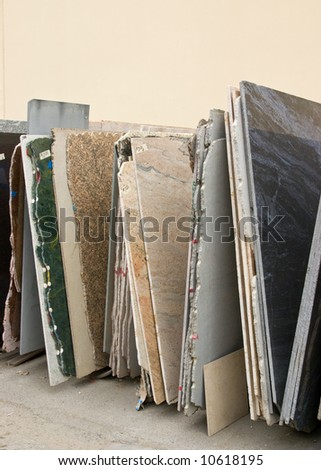 Colorful granite slabs for sale in store yard - stock photo
