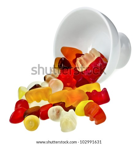 Colorful gummy candies in a bowl isolated on white