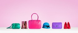 Colorful hand bags,shoes, and hat isolated on pink background. Woman fashion accessories item. Shopping image.