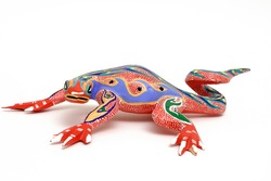 Colorful hand carved lizard. Called Alebrije.   Done by street vendors in Oaxaca, Mexico. They are safe to use since the designs have been passed from generation to generation.