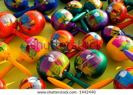 Colorful hand painted maracas at a Mexican market. - stock photo
