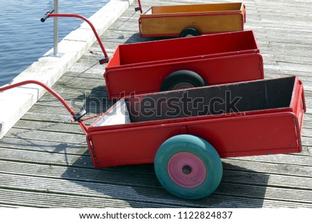 Colorful handcarts at the harbor - Shutterstock ID 1122824837