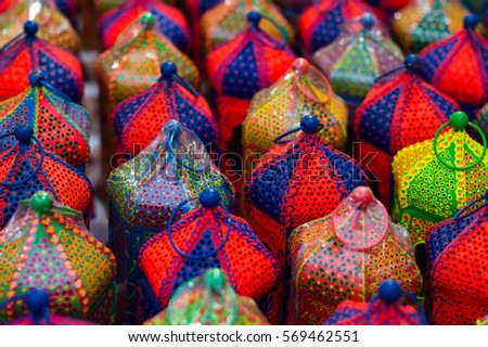 Colorful handicraft lanterns laid out together. Various designs and colors are available
