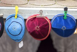 Colorful handmade Jewish caps with Star of David , Kippah, sold  in the street shop before entering the Klausen Synagogue, Prague, Czech Republic