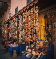 Colorful handmade leather slippers babouches on a market souk in the medina of Marrakech, Morocco