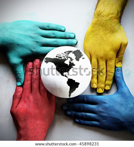 colorful hands holding the earth