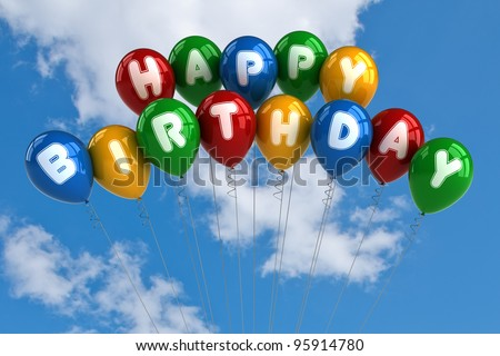 Colorful happy birthday balloons in front of blue sky