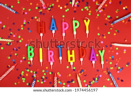 Colorful happy birthday candles on a red background Stock foto ©