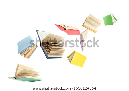 Photo of  Colorful hardcover books flying on white background