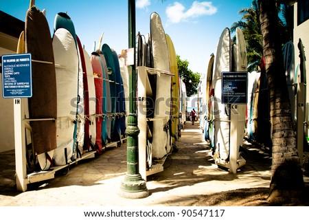 Colorful hawaiian surf boards parking rack in waikiki