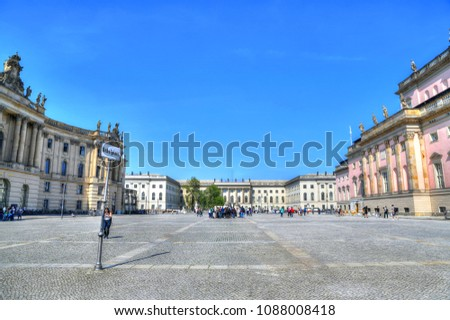 colorful HDR image of the Alte Bibliothek of the Humboldt - the law faculty and the Berlin State Opera at the famous Bebelplatz in the center of Berlin