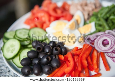 Colorful healthy organic salad with different vegetables, eggs and tuna