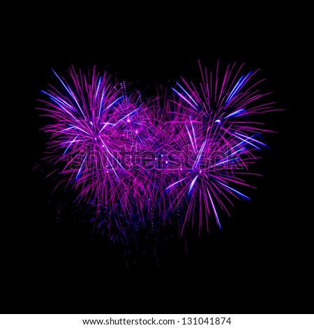 Colorful heart fireworks on the black sky background