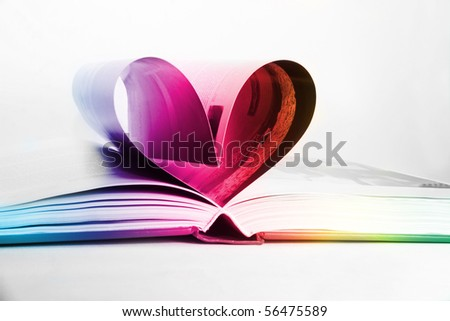 colorful heart made with book pages - stock photo