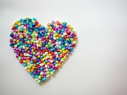 Colorful heart shape made with paper stars