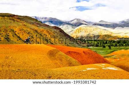 Colorful hills in a mountain valley. Mountain hills landscape. Orange mountain hills panorama