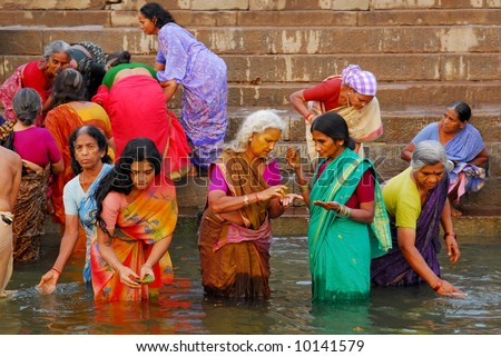 Colorful Hindu Women Bathing In The Ganges In Varanasi Stock Photo ...
