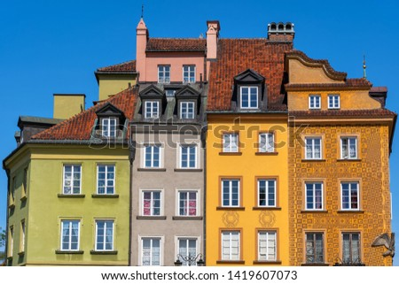 Colorful historic tenement houses in the Old Town of Warsaw city in Poland.