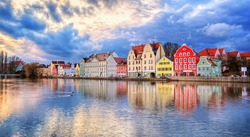 Colorful historical houses on Isar river in an old gothic town Landshut by Munich, Germany