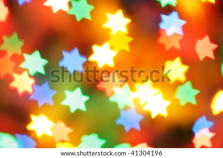 Colorful holiday illumination out of focus, may be used as background - stock photo
