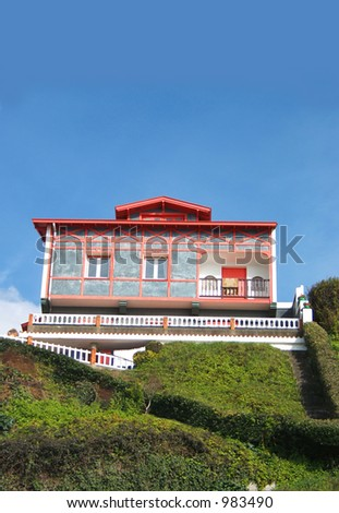 colorful home for real state. With space for text in the clear sky