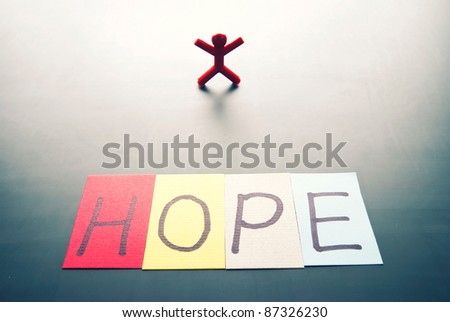 Colorful hope word and single person with back light shadow