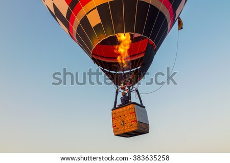 Colorful hot air balloon early in the morning in Hungary #383635258